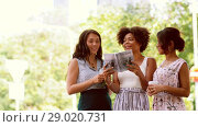 Купить «women with city guide and drinks on street», видеоролик № 29020731, снято 15 августа 2018 г. (c) Syda Productions / Фотобанк Лори