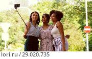 Купить «women taking selfie by smartphone in city», видеоролик № 29020735, снято 15 августа 2018 г. (c) Syda Productions / Фотобанк Лори