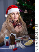 Купить «Unhealthy female is sitting in a plaid with medications in the New Year night», фото № 29021415, снято 6 января 2018 г. (c) Яков Филимонов / Фотобанк Лори