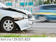 Купить «car accident on street. damaged automobile after crash in city», фото № 29021823, снято 14 июля 2018 г. (c) Дмитрий Калиновский / Фотобанк Лори