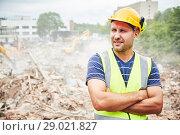 Купить «Demolition construction work. Worker at building site», фото № 29021827, снято 24 июля 2018 г. (c) Дмитрий Калиновский / Фотобанк Лори