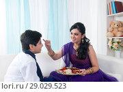 Купить «Sister applying tilak to her brother at Raksha Bandhan», фото № 29029523, снято 8 октября 2013 г. (c) easy Fotostock / Фотобанк Лори