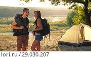 Купить «Couple traveling with backpacks», видеоролик № 29030207, снято 31 августа 2018 г. (c) Илья Шаматура / Фотобанк Лори