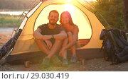 Купить «Smiling couple in a tent», видеоролик № 29030419, снято 31 августа 2018 г. (c) Илья Шаматура / Фотобанк Лори