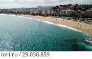 Купить «Picturesque aerial view of Mediterranean coastal town of Lloret de Mar in Catalonia, Spain», видеоролик № 29030859, снято 11 июня 2018 г. (c) Яков Филимонов / Фотобанк Лори