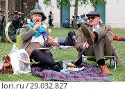 Купить «Riders gather for a picnic in Geraldine Mary Harnsworth Park. The Tweed Run is one of London's most visually stunning and wonderfully British public bicycle...», фото № 29032827, снято 6 мая 2017 г. (c) age Fotostock / Фотобанк Лори