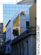 Купить «Building with mirror glass windows in a street of Alicante, Valencia, Spain», фото № 29034047, снято 23 декабря 2016 г. (c) age Fotostock / Фотобанк Лори