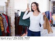 Купить «Cute girl customer with packs delighted from purchases», фото № 29035707, снято 17 января 2018 г. (c) Яков Филимонов / Фотобанк Лори