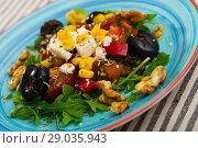 Salad with arugula, olives, Feta cheese, corn and walnut is tasty dish. Стоковое фото, фотограф Яков Филимонов / Фотобанк Лори