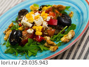 Купить «Salad with arugula, olives, Feta cheese, corn and walnut is tasty dish», фото № 29035943, снято 22 июня 2018 г. (c) Яков Филимонов / Фотобанк Лори