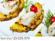 Купить «Photography of plate with sepia fried on a grill with pineapple, cherry tomatoes and sauce Chile», фото № 29035979, снято 18 декабря 2018 г. (c) Яков Филимонов / Фотобанк Лори