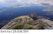 Купить «Сlouds are reflected in the water Norwegian fjord in sunny day, Averoy, Norway», видеоролик № 29036591, снято 1 сентября 2018 г. (c) Некрасов Андрей / Фотобанк Лори