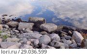 Купить «Сlouds are reflected in the water Norwegian fjord in sunny day, Averoy, Norway», видеоролик № 29036599, снято 1 сентября 2018 г. (c) Некрасов Андрей / Фотобанк Лори