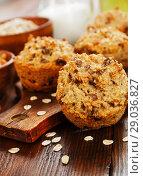 Купить «Diet oat muffins with raisins», фото № 29036827, снято 1 апреля 2018 г. (c) Надежда Мишкова / Фотобанк Лори