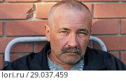Купить «Sad man with mustaches», видеоролик № 29037459, снято 2 сентября 2018 г. (c) Илья Шаматура / Фотобанк Лори