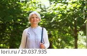 Купить «happy senior woman walking along summer park», видеоролик № 29037935, снято 21 августа 2018 г. (c) Syda Productions / Фотобанк Лори