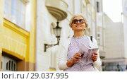 Купить «senior woman or tourist with city guide on street», видеоролик № 29037995, снято 21 августа 2018 г. (c) Syda Productions / Фотобанк Лори