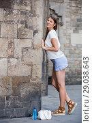 Купить «Romantic girl leaning against stone wall», фото № 29038643, снято 15 августа 2017 г. (c) Яков Филимонов / Фотобанк Лори