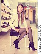 Купить «Cheerful woman is posing with handbag and modern shoes», фото № 29038707, снято 13 декабря 2017 г. (c) Яков Филимонов / Фотобанк Лори