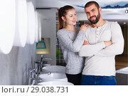 Купить «Young family couple choosing bathroom sink in store», фото № 29038731, снято 2 февраля 2018 г. (c) Яков Филимонов / Фотобанк Лори