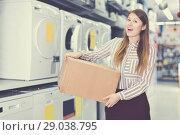 Купить «Portrait of positive young woman with box», фото № 29038795, снято 12 декабря 2017 г. (c) Яков Филимонов / Фотобанк Лори