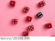 Купить «Red and black gaming dices on pink background», фото № 29038999, снято 3 января 2018 г. (c) Pavel Biryukov / Фотобанк Лори