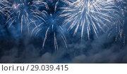 Купить «Celebratory colorful fireworks exploding in the skies», фото № 29039415, снято 10 августа 2013 г. (c) Владимир Журавлев / Фотобанк Лори