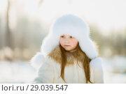 Купить «Winter portrait of little girl in fur coat», фото № 29039547, снято 25 января 2018 г. (c) Julia Shepeleva / Фотобанк Лори