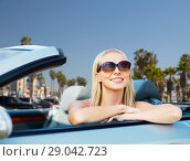 Купить «happy young woman in convertible car», фото № 29042723, снято 17 августа 2017 г. (c) Syda Productions / Фотобанк Лори