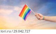Купить «hand with gay pride rainbow flag and wristband», фото № 29042727, снято 2 ноября 2017 г. (c) Syda Productions / Фотобанк Лори