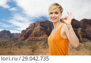 Купить «happy smiling young woman showing ok hand sign», фото № 29042735, снято 30 июня 2018 г. (c) Syda Productions / Фотобанк Лори