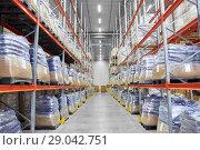cargo storing at warehouse shelves. Стоковое фото, фотограф Syda Productions / Фотобанк Лори