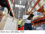 Купить «businessman and worker on forklift at warehouse», фото № 29042759, снято 9 декабря 2015 г. (c) Syda Productions / Фотобанк Лори