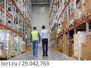 Купить «businessman and worker walking along warehouse», фото № 29042763, снято 9 декабря 2015 г. (c) Syda Productions / Фотобанк Лори
