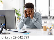 Купить «stressed businessman with papers at office», фото № 29042799, снято 7 апреля 2018 г. (c) Syda Productions / Фотобанк Лори
