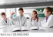 Купить «kids with test tubes studying chemistry at school», фото № 29043043, снято 19 мая 2018 г. (c) Syda Productions / Фотобанк Лори