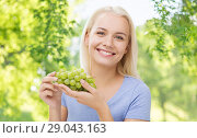 happy smiling woman with grapes. Стоковое фото, фотограф Syda Productions / Фотобанк Лори