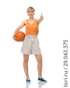Купить «teenage girl with basketball showing thumbs up», фото № 29043375, снято 30 июня 2018 г. (c) Syda Productions / Фотобанк Лори