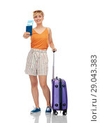 Купить «smiling teenage girl with travel bag and air ticket», фото № 29043383, снято 30 июня 2018 г. (c) Syda Productions / Фотобанк Лори