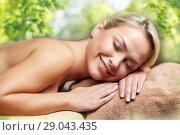 Купить «young woman lying on massage table in spa», фото № 29043435, снято 18 декабря 2014 г. (c) Syda Productions / Фотобанк Лори