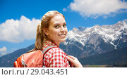 Купить «smiling woman with backpack over alps mountains», фото № 29043451, снято 25 июля 2015 г. (c) Syda Productions / Фотобанк Лори