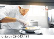 Купить «happy male chef cooking food at restaurant kitchen», фото № 29043491, снято 2 апреля 2017 г. (c) Syda Productions / Фотобанк Лори