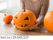 Купить «close up of woman with halloween pumpkin at home», фото № 29043527, снято 15 сентября 2017 г. (c) Syda Productions / Фотобанк Лори