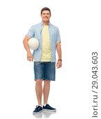 Купить «smiling young man with volleyball», фото № 29043603, снято 30 июня 2018 г. (c) Syda Productions / Фотобанк Лори