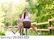 Купить «happy couple with bicycles at summer park», фото № 29043659, снято 15 июля 2018 г. (c) Syda Productions / Фотобанк Лори