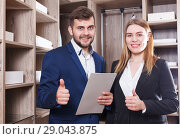 Купить «Two sales managers with papers», фото № 29043875, снято 9 апреля 2018 г. (c) Яков Филимонов / Фотобанк Лори