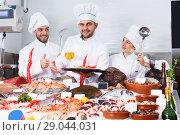 Купить «chefs offering fresh marine products for tasting», фото № 29044031, снято 26 января 2018 г. (c) Яков Филимонов / Фотобанк Лори