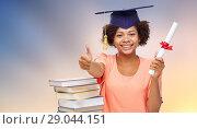 Купить «african graduate student with books and diploma», фото № 29044151, снято 8 июля 2015 г. (c) Syda Productions / Фотобанк Лори