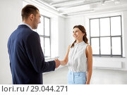 Купить «businesswoman and businessman shaking hands», фото № 29044271, снято 8 июня 2018 г. (c) Syda Productions / Фотобанк Лори