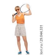 Купить «smiling teenage girl with tennis racket», фото № 29044331, снято 30 июня 2018 г. (c) Syda Productions / Фотобанк Лори
